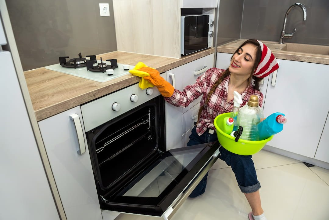 woman-cleaning-oven